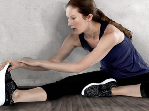 Woman stretching before workout